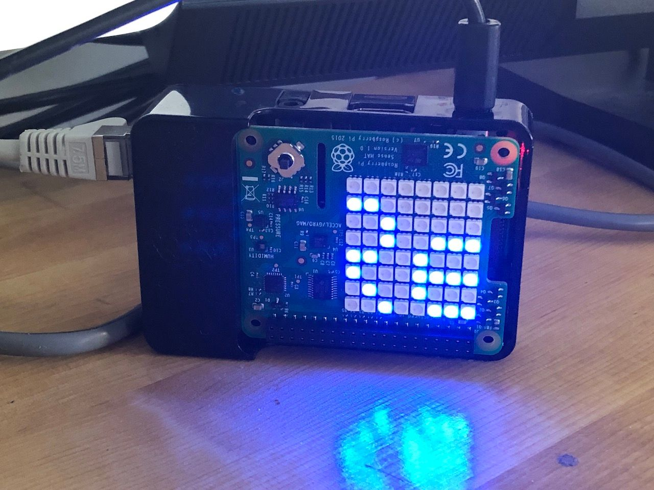 raspberry with scrolling text on a sense hat matrix display